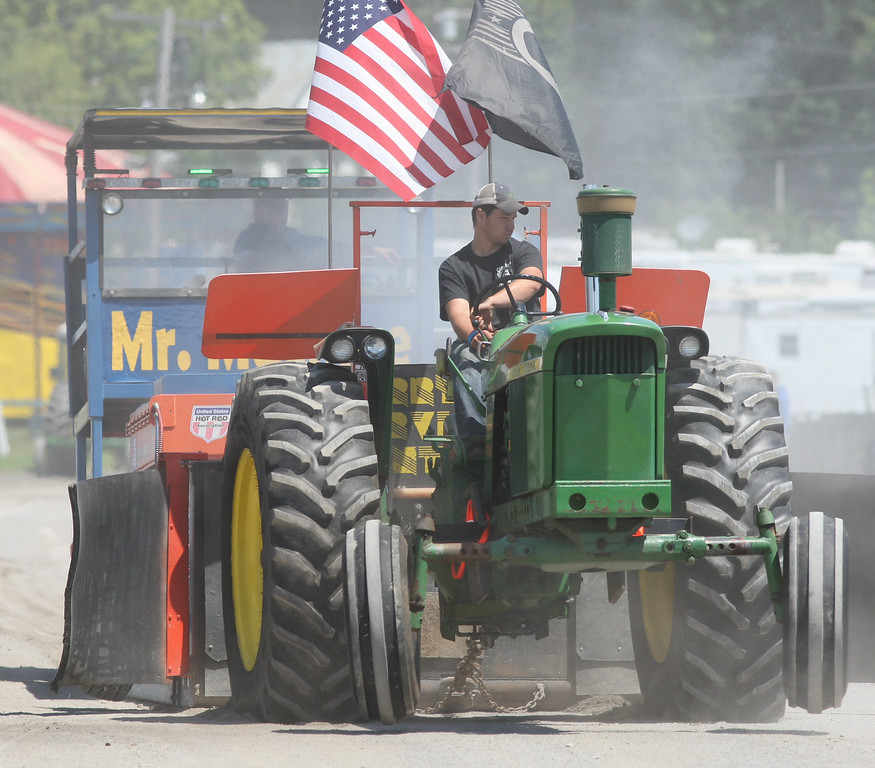 . Kyle Smith competes in the tractor pull competition at the Boonville Oneida County Fair on Thursday, July 24, 2014 in Boonville. The fair runs through Sunday, July 27, 2014. JOHN HAEGER-ONEIDA DAILY DISPATCH @ONEIDAPHOTO ON TWITTER