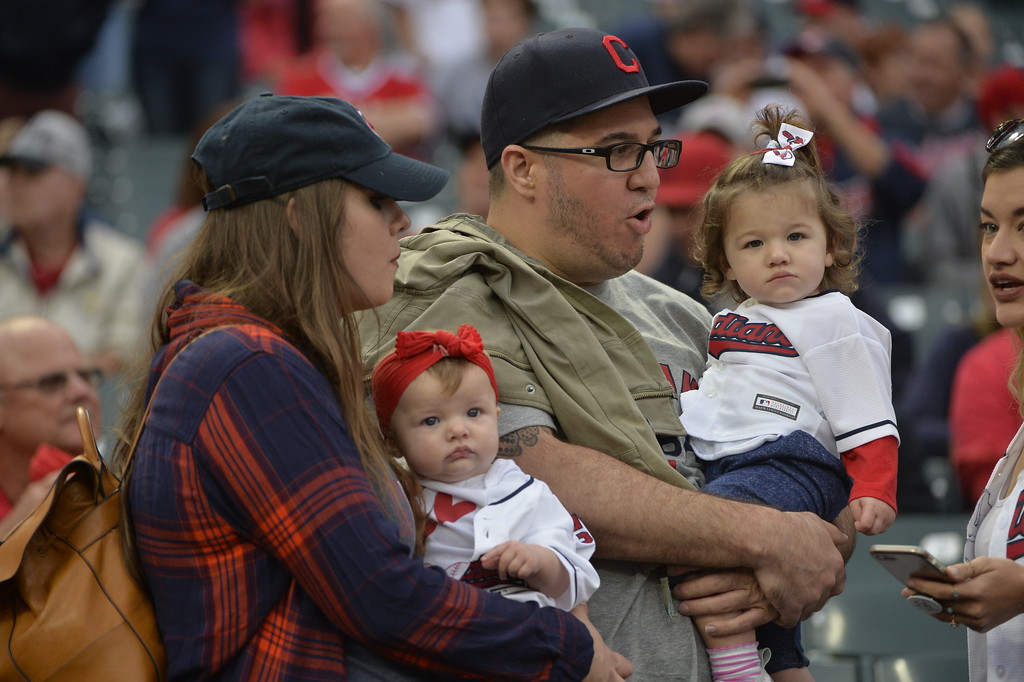 . Rachel Sauer and Tyler Hunt hold Cleveland Indians starting pitcher Mike Clevinger\'s children before Game 2 of baseball\'s American League Division Series between the New York Yankees and the Cleveland Indians, Friday, Oct. 6, 2017, in Cleveland. Sauer is holding Piper, 6 months, and Hunt is holding Penelope Grace, 18 months. (AP Photo/Phil Long)