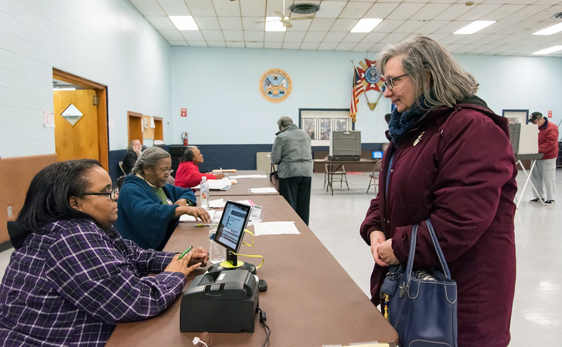 02/26/19  Wesley Bunnell | Staff  Approximately 120 voters as of 2:00pm at the VFW Post 511 Memorial Hall voting location for the 6th state Senate District seat. Cathy Teti , R, hands over her drivers license to check in at the voting location.