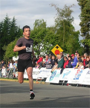 2003 Times-Colonist 10K - Pierre Ballester leaps from shadow to shadow