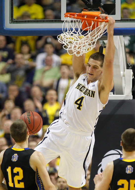 . Michigan Wolverines\' Mitch McGary finishes off a dunk against the South Dakota State Jackrabbits during first-half action in the men\'s NCAA basketball tournament at The Palace of Auburn Hills in Auburn Hills, Michigan, Thursday, March 21, 2013. (Julian H. Gonzalez/Detroit Free Press/MCT)