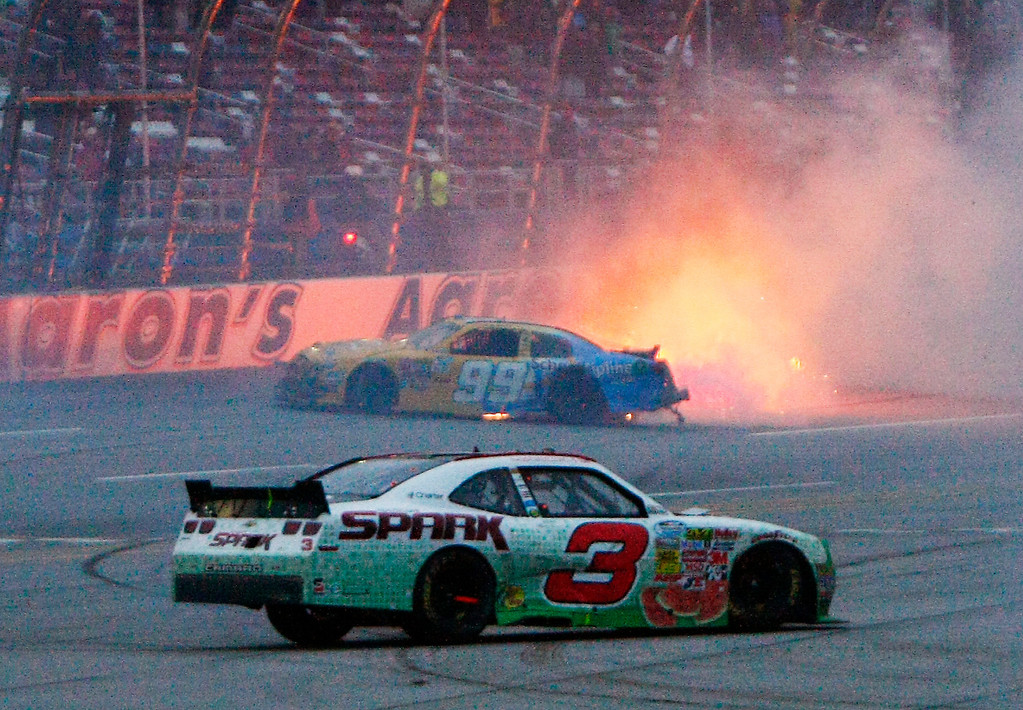 . Austin Dillon (3) spins as Alex Bowman (99) catches fire in a last-lap wreck during the NASACR Nationwide Series auto race at Talladega Superspeedway in Talladega, Ala., Saturday, May 4, 2013. (AP Photo/Ron Sanders)