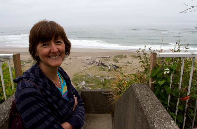 Deborah doesn't mind the cool and misty days of the Oregon coast.