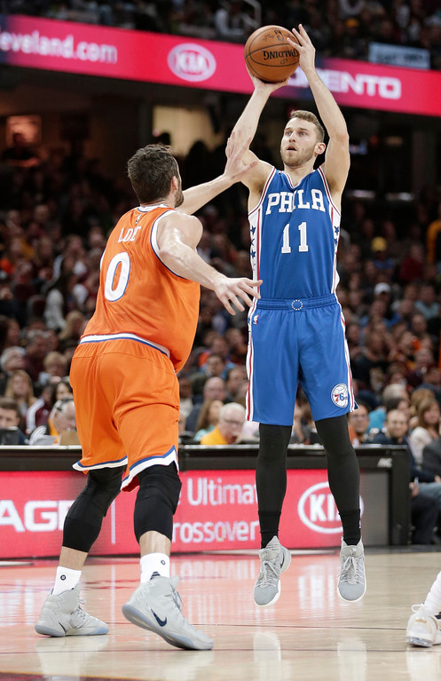 . Philadelphia 76ers\' Nik Stauskas (11) shoots over Cleveland Cavaliers\' Kevin Love (0) in the second half of an NBA basketball game, Friday, March 31, 2017, in Cleveland. The Cavaliers won 122-105. (AP Photo/Tony Dejak)