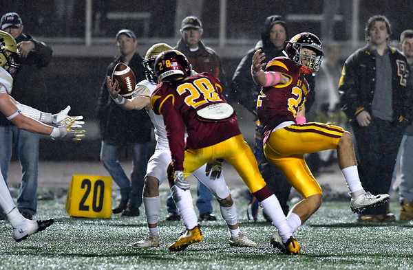 12/14/2019 Mike Orazzi | Staff Daniel Hand's Seth Sweitzer (7) catches a tipped pass during a 17-13 St. Joseph win at Veteran's Stadium in New Britain on Saturday. 