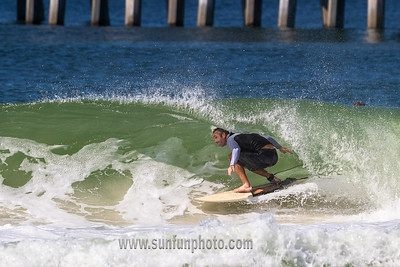 Surfing the County Pier Panama City Beach