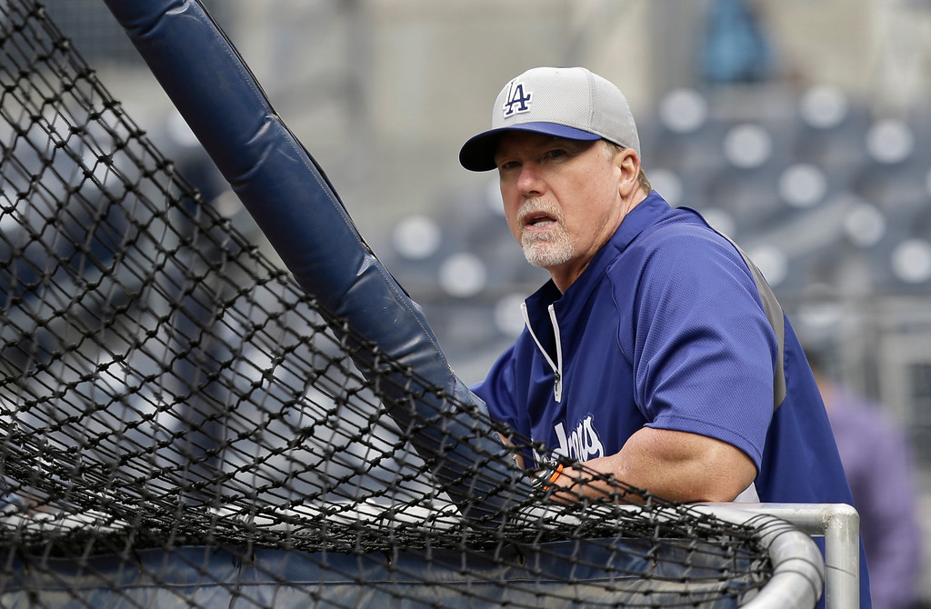 . Los Angeles Dodgers batting coach Mark McGwire watches his team during batting practice before a baseball game against the San Diego Padres in San Diego, Thursday, April 11, 2013. (AP Photo/Lenny Ignelzi)