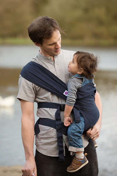 Izmi_Baby_Carrier_Cotton_Midnight_Blue_Lifestyle_Side_Carry_Dad_Looking_At_Son_Portrait.jpg