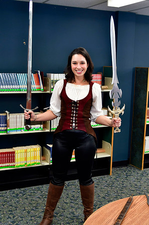 11/10/2018 Mike Orazzi   Staff Southington Childrens Librarian Molly Virello holds one of the items on display during a Renaissance Faire held at the Southington Public Library Saturday.