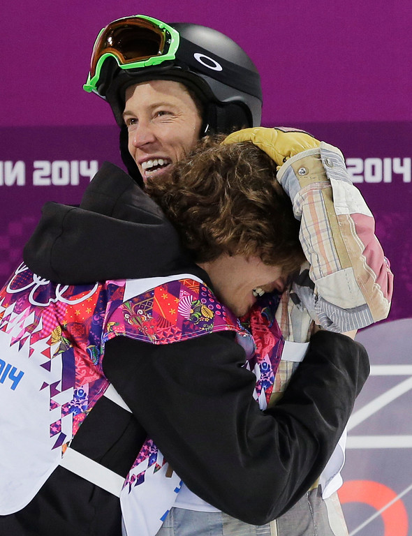 . Switzerland\'s Iouri Podladtchikov, bottom, celebrates with Shaun White of the United States after Podladtchikov won the gold medal in the men\'s snowboard halfpipe final at the Rosa Khutor Extreme Park, at the 2014 Winter Olympics, Tuesday, Feb. 11, 2014, in Krasnaya Polyana, Russia. (AP Photo/Andy Wong)