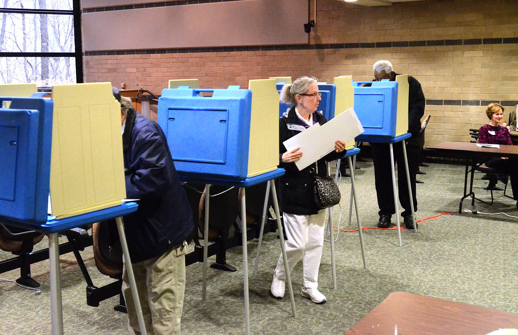 . Voters at precinct #24 in the Rochester Hills City Hall.    Tuesday, November 4, 2014.  Tim Thompson-The Oakland Press