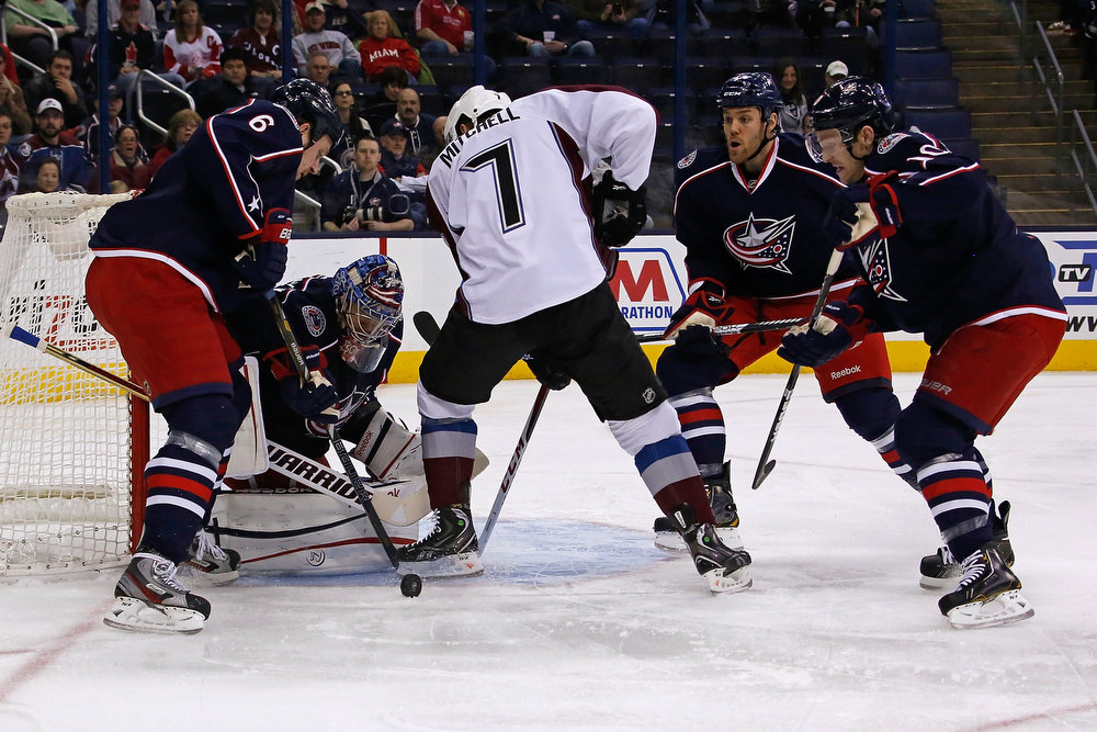 . Sergei Bobrovsky #72 of the Columbus Blue Jackets makes a save on a shot from John Mitchell #7 of the Colorado Avalanche as Nikita Nikitin #6 of the Columbus Blue Jackets clears out the rebound and Dalton Prout #47 of the Columbus Blue Jackets and Mark Letestu #10 of the Columbus Blue Jackets help on defense during the first period on March 3, 2013 at Nationwide Arena in Columbus, Ohio. (Photo by Kirk Irwin/Getty Images)