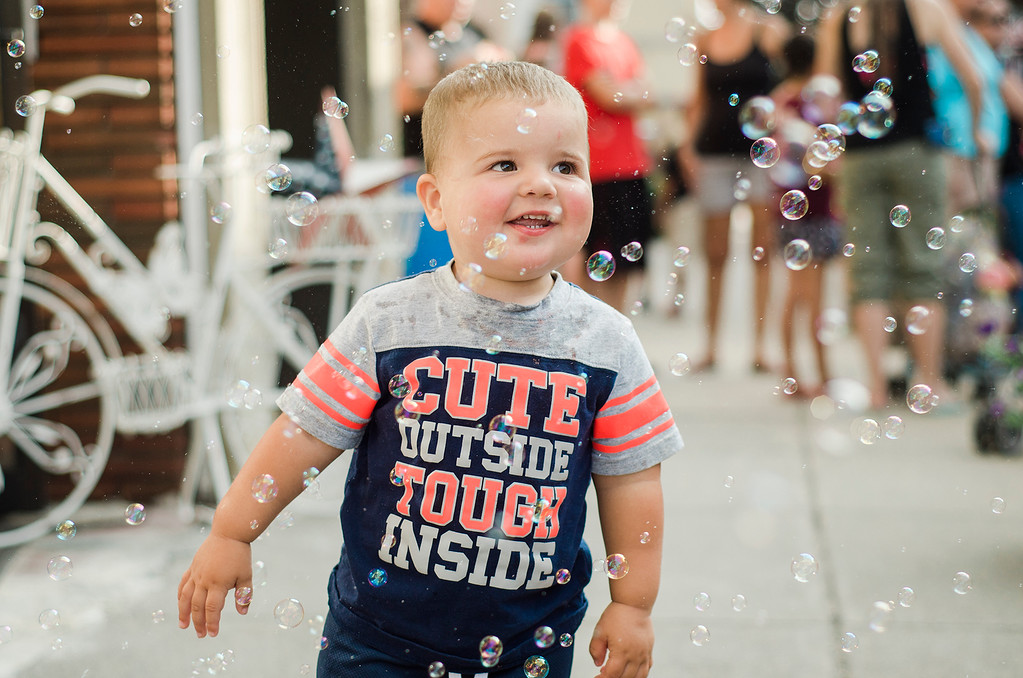 . Jack Conner, 1, runs through bubbles during Leominster Kid\'s Day on Saturday, August 26, 2017. SENTINEL & ENTERPRISE / Ashley Green