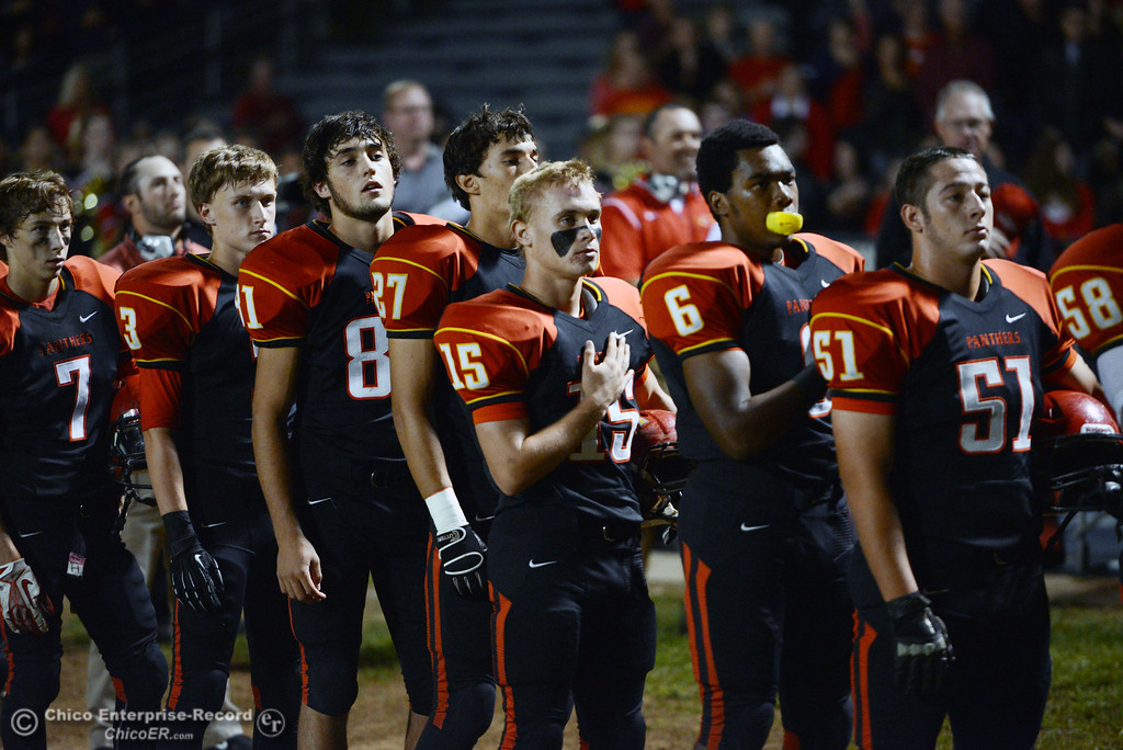 . Chico High\'s #3 Christian Click, #81 Nathan Heyl, #27 Noah Collado, #15 Miles Fishback, #6 Darius Broadway, and #51 Kody Sonday (left to right) stand for the National Anthem against Central Valley High in the first quarter of their football game at Asgard Yard Friday, September 27, 2013, in Chico, Calif.  (Jason Halley/Chico Enterprise-Record)