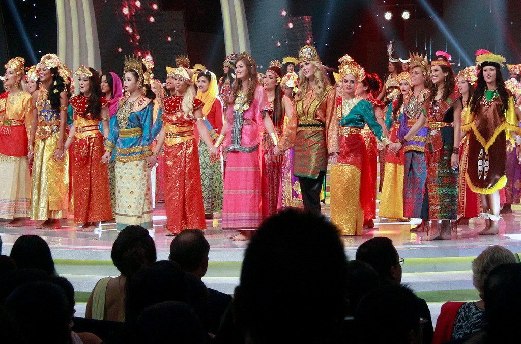 . In this Sunday, Sept. 8, 2013 photo, contestants wear traditional Indonesian outfits during the opening ceremony of Miss World 2013 pageant in Nusa Dua, Bali, Indonesia. Beauty queens and backstage drama may seem inevitable, but at this year\'s Miss World competition, something more serious than hair-pulling and name-calling has come from host country Indonesia: Muslim hardliners have threatened to hijack the competition despite major concessions from the government and organizers. (AP Photo/Firdia Lisnawati)