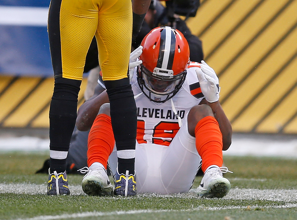 . Cleveland Browns wide receiver Corey Coleman (19) sits on the field after allowing a pass from quarterback DeShone Kizer to go through his hands for an incompletion during the second half of an NFL football game against the Pittsburgh Steelers in Pittsburgh, Sunday, Dec. 31, 2017. The Steelers won 28-24. (AP Photo/Keith Srakocic)