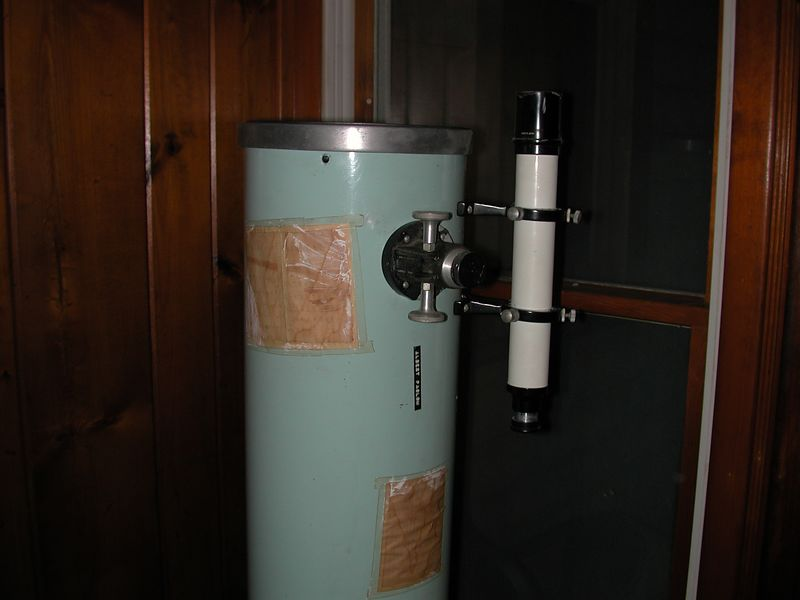 """This is the tube assembly of my original 8 inch relector telescope built between 1967 and 1970. I ground and polished the mirror and used a Parks """"blue"""" fiberglass tube. The focuser is Telescopics and the finder is a genuine """"Unitron"""" 10 x 40 mm item.  I placed some photography charts to the instrument in the early 70's and they are still attached ."""