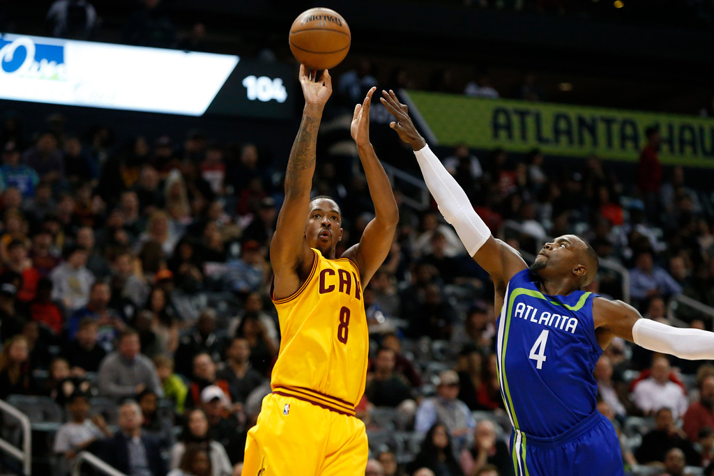 . Cleveland Cavaliers forward Channing Frye (8) shoots over Atlanta Hawks forward Paul Millsap (4) in the second half of an NBA basketball game, Friday, March 3, 2017, in Atlanta. The Cavaliers won 135-130. (AP Photo/Brett Davis)