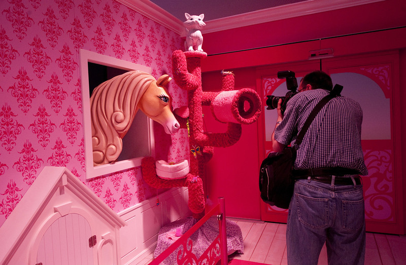 . A photographer take pictures inside the Dreamhouse - the first life-sized giant mansion dedicated to the doll in Europe, ahead of its opening near the Alexanderplatz in Berlin on May 16, 2013. BARBARA SAX/AFP/Getty Images