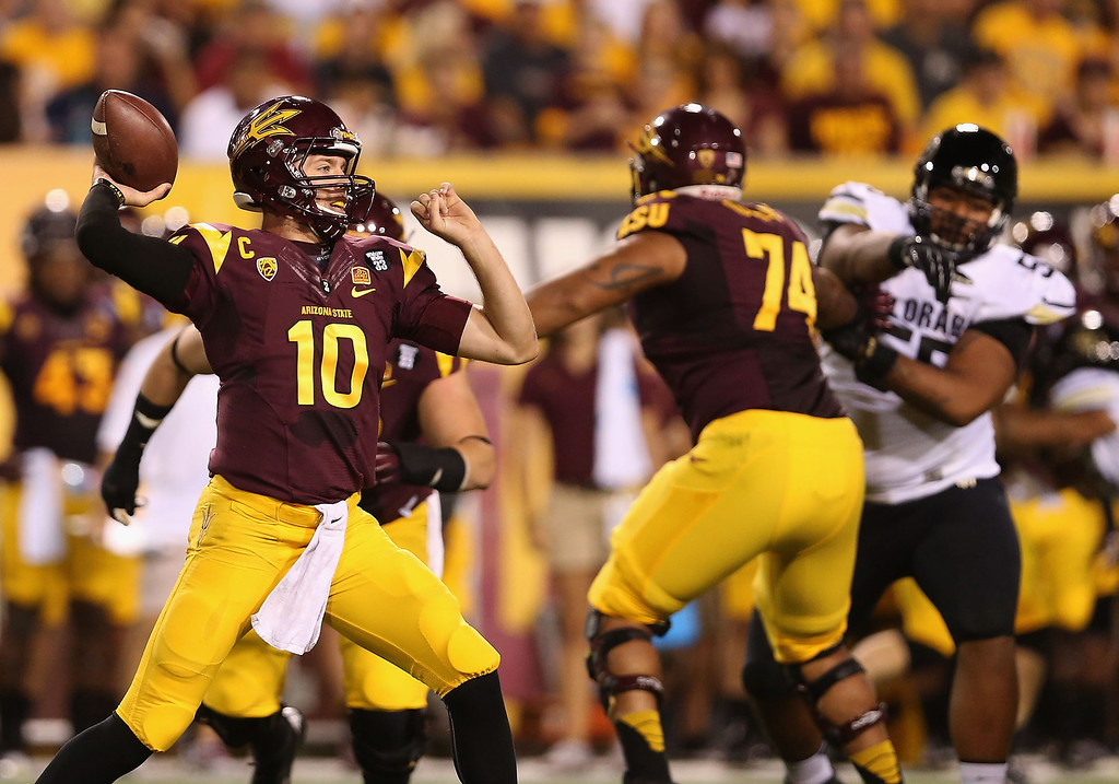 . TEMPE, AZ - OCTOBER 12:  Quarterback Taylor Kelly #10 of the Arizona State Sun Devils throws a pass during the college football game against the Colorado Buffaloes at Sun Devil Stadium on October 12, 2013 in Tempe, Arizona.  (Photo by Christian Petersen/Getty Images)