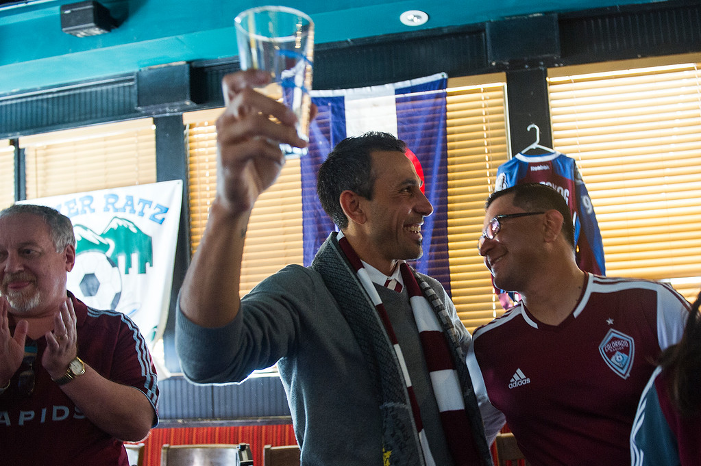 . Pablo Mastroeni, former player and captain for the Colorado Rapids, raises an empty glass while surrounded by fans at the Celtic Tavern after being introduced as the team\'s new head coach on March 8, 2014, in Denver, Colorado. (Photo by Daniel Petty/The Denver Post)