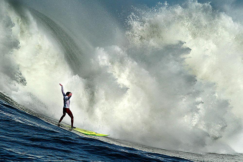 Description of . Shane Desmond, of Santa Cruz, California exults while finishing a ride during the annual Mavericks Surf Contest in 2005. Photo by Shmuel Thaler/Santa Cruz Sentinel