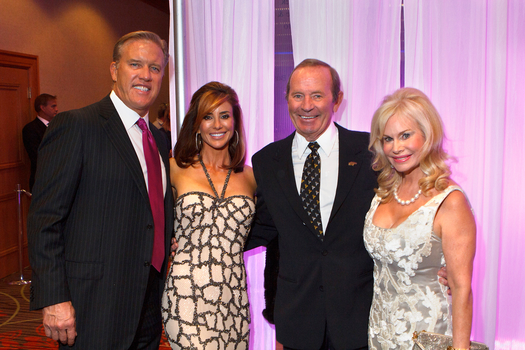 . John and Paige Elway, left, with Pat and Annabel Bowlen. Annabel Bowlen chaired the benefit\'s auction committee. Photo by Steve Peterson, Special to The Denver Post