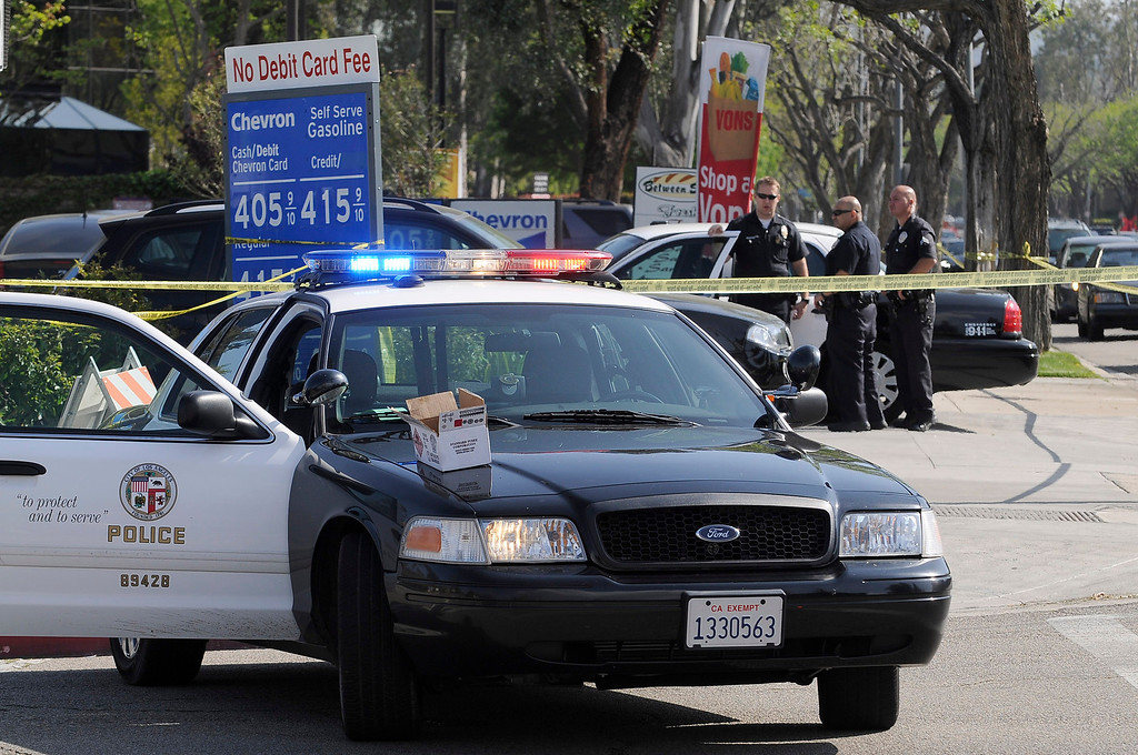. Police officers gather around the Starbucks Coffee located at the intersection of Canoga and Oxnard in Woodland Hills.A 10-year-old girl who was reported missing from her family\'s Northridge home was found safe Monday afternoon in Woodland Hills, and police said it was unclear whether she had been abducted or ran away. After an 11-hour search, Nicole Ryan was found near a strip mall about six miles from her home, Los Angeles police Capt. Kris Pitcher said. Woodland Hills,CA 3/26/2013(John McCoy/Staff Photographer
