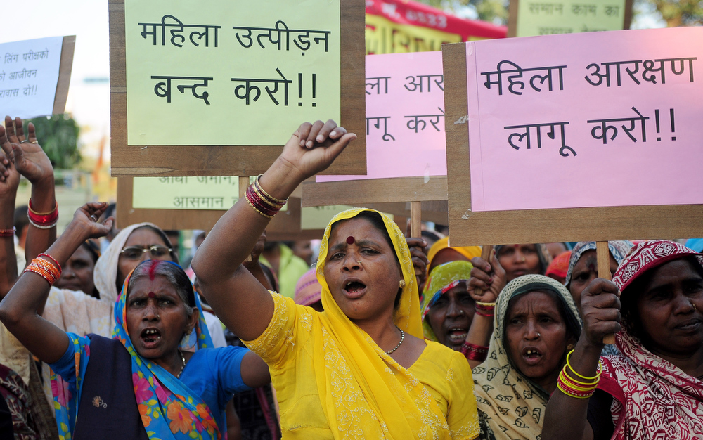. Mahila Adhikar Manch activists shout anti-government slogans during a rally on International World Women\'s day in Allahabad on March 8, 2013. The demonstrators were demanding the passing of the bill which will reserve 33 per cent of all seats in the Lower house of Parliament and in all state legislative assemblies to women.  Sanjay Kanojia/AFP/Getty Images