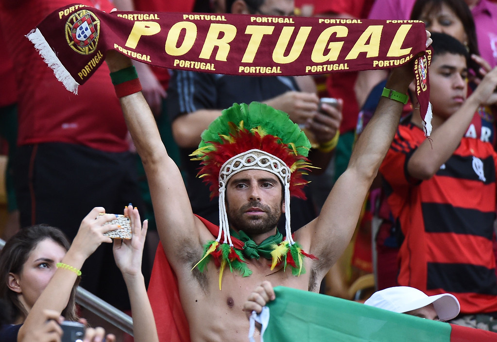 . Portugal fans cheer before the start of a Group G match between USA and Portugal at the Amazonia Arena in Manaus during the 2014 FIFA World Cup on June 22, 2014.    RAPHAEL ALVES/AFP/Getty Images