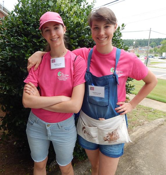 Sisters Sophie and Jasmine Luedi (granddaughters of Millard and Linda Fuller) pose during the Lind-A Hand Build (Linda Fuller's Build for Women) in Lanett, Alabama, in June 2015.