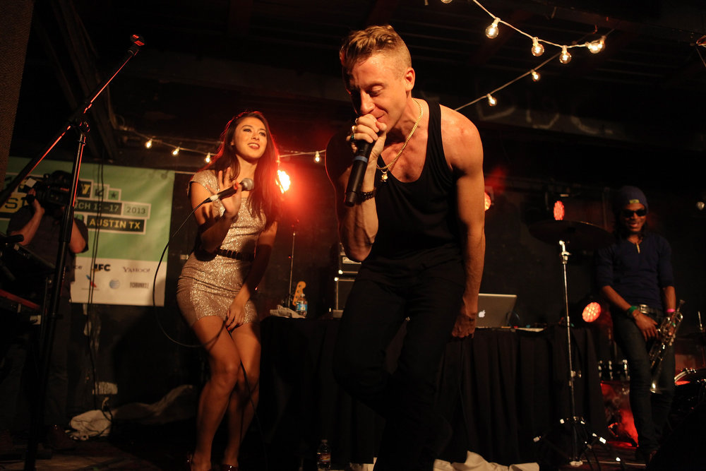 . Macklemore performs onstage at the iHeartRadio Official SXSW Showcase on March 12, 2013 in Austin, Texas.  (Photo by Roger Kisby/Getty Images for iHeartradio)