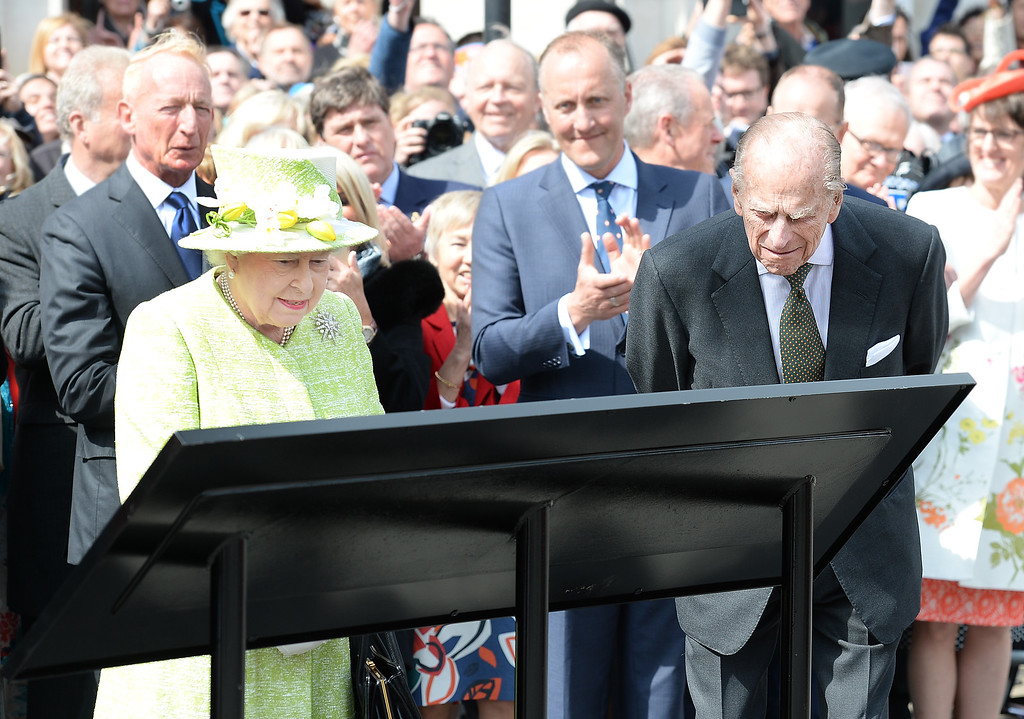. Britain\'s Queen Elizabeth II and Prince Philip study a plaque after she unveiled it, during a walkabout close to Windsor Castle as she celebrates her 90th birthday, in Berkshire, England, Thursday, April 21, 2016. (John Stillwell/Pool Photo via AP)