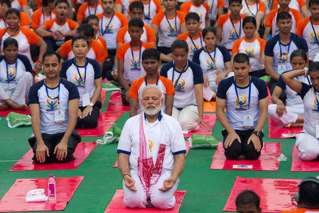 . Indian Prime Minister Narendra Modi, center, performs yoga along with thousands of Indians in Lucknow, India, Wednesday, June 21, 2017. Millions of yoga enthusiasts across India take part in a mass yoga sessions to mark the third International Yoga Day which falls on June 21 every year. (AP Photo/Rajesh Kumar Singh)