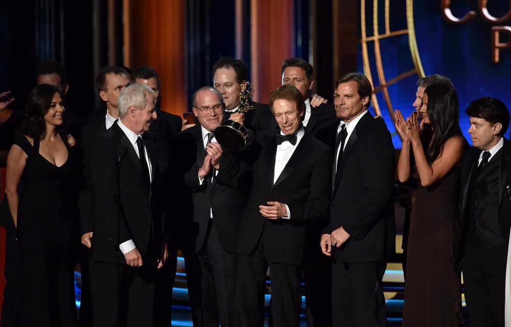 . (L-R) Producers Bertram van Munster, Jonathan Littman and Jerry Bruckheimer accept Outstanding Reality - Competition Program for \'The Amazing Race\' onstage at the 66th Annual Primetime Emmy Awards held at Nokia Theatre L.A. Live on August 25, 2014 in Los Angeles, California.  (Photo by Kevin Winter/Getty Images)