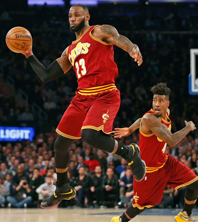 . Cleveland Cavaliers forward LeBron James (23) passes as Cleveland Cavaliers guard Iman Shumpert (4) runs behind him in the first quarter of an NBA basketball game against the New York Knicks at Madison Square Garden in New York, Wednesday, Dec. 7, 2016. (AP Photo/Kathy Willens)