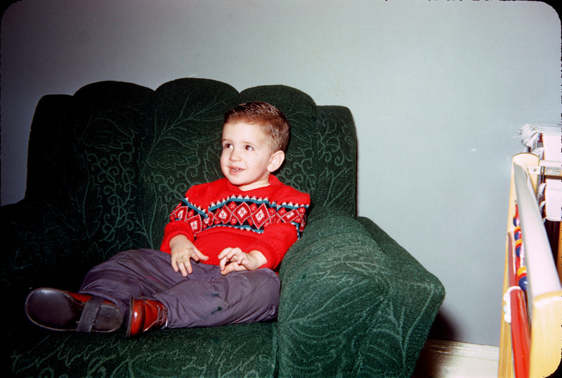 richard with red sweater in chair.jpg