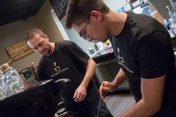 01/27/20 Wesley Bunnell | StaffrrCo-owner Doug Lamonthe, L, and employee Nathan Virovoy, prepare a hot chocolate at the Roasted Bean coffee shop. The shop which opened approximately two weeks ago is located at 934 Terryville Ave in Bristol.