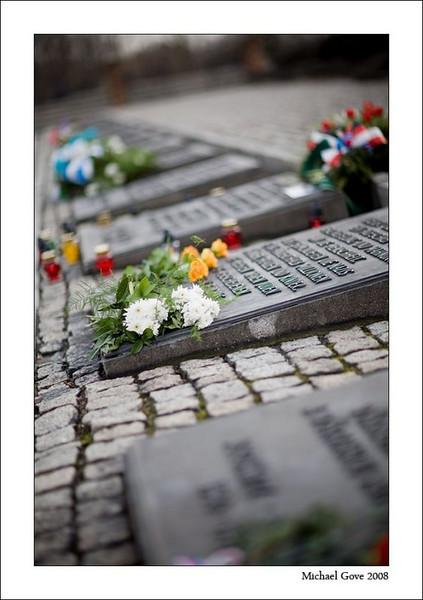 Between the ruined crematoria are tributes laid at the International Monument to the Victims of Auschwitz (94640205).jpg
