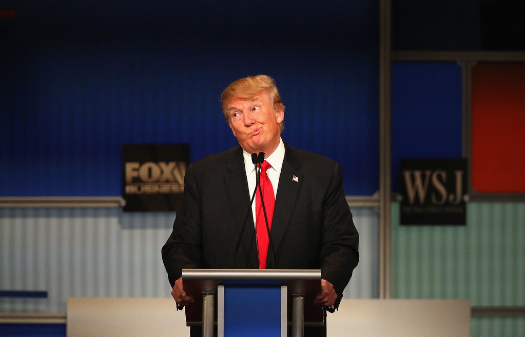 . Presidential candidate Donald Trump gestures after Carly Fiorina says she met with Russian President Putin at a one on one meeting, during the Republican Presidential Debate sponsored by Fox Business and the Wall Street Journal at the Milwaukee Theatre November 10, 2015 in Milwaukee, Wisconsin. The fourth Republican debate is held in two parts, one main debate for the top eight candidates, and another for four other candidates lower in the current polls.  (Photo by Scott Olson/Getty Images)