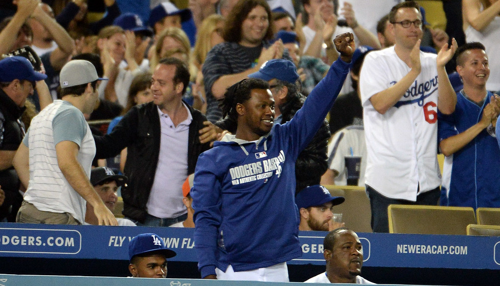 . Los Angeles Dodgers\' Hanley Ramirez cheers as teammate Adrian Gonzalez (not pictured) doubles in the ninth inning as the Los Angeles Dodgers defeat the San Diego Padres 1-0 during a Major league baseball game on Saturday, July 12, 2014 in Los Angeles. Los Angeles Dodgers won 1-0.   (Keith Birmingham/Pasadena Star-News)