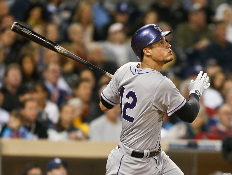 . Colorado Rockies\' Nolan Arenado watches his RBI sacrifice fly against the San Diego Padres in the fourth inning of a baseball game Tuesday, April 15, 2014, in San Diego. (AP Photo/Lenny Ignelzi)