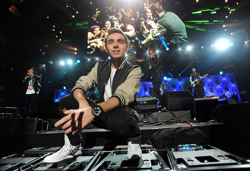Description of . Singer Nathan Sykes and the rest of the group The Wanted perform at Z100's Jingle Ball 2012 presented by Aeropostale at Madison Square Garden on Friday Dec. 7, 2012 in New York. (Photo by Evan Agostini/Invision/AP)