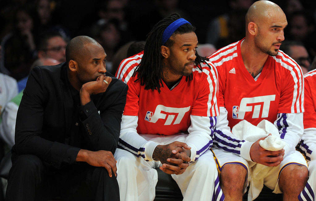 . Injured Lakers star Kobe Bryant, left, watches the action from the bench against the Nuggets at the Staple Center in Los Angeles, CA on Sunday, January 5, 2014. 1st half.  (Photo by Scott Varley, Daily Breeze)