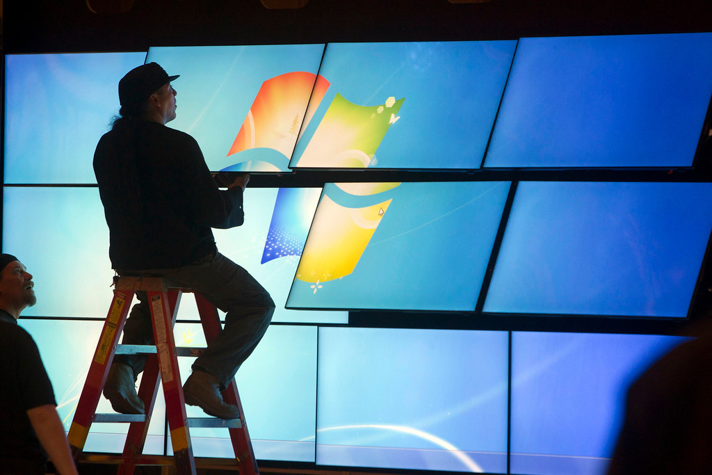 . A technician works on a video wall for a Samsung booth in the lobby of the Las Vegas Convention Center as exhibitors prepare for the International CES in Las Vegas, Nev., on  Jan. 5, 2013. (REUTERS/Steve Marcus)