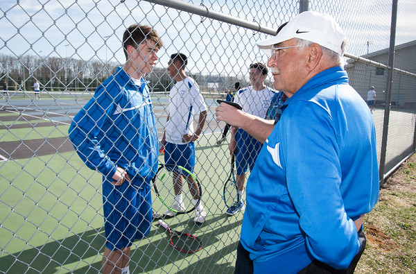04/17/19 Wesley Bunnell | Staff Southington boys tennis hosted Berlin on Wednesday afternoon at Southington High School. Southington Head Coach Tony Mauro stands to the side as a player is interviewed.