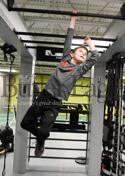 Harold Aughton/Butler Eagle: Hayden Stadtmiller, 12, of South Butler works out on the new Queenex Rig at the Butler YMCA, Monday, Dec. 2, 2019.