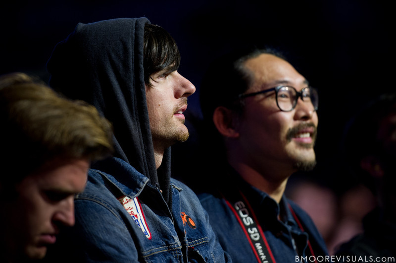 Seth Avett and Joe Kwon of The Avett Brothers watch as The Raconteurs perform at The Citrus Bowl in Orlando, Florida during Orlando Calling on November 12, 2011