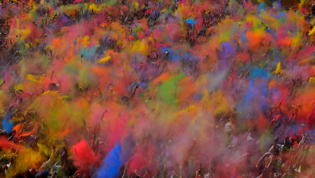 . Visitors of the Holi Festival of Colours throw special colored powders in the air in Barcelona, Spain, Sunday, April 6, 2014. The festival is fashioned after the Hindu spring festival Holi, which is mainly celebrated in the north and east of India. (AP Photo/Manu Fernandez, File)