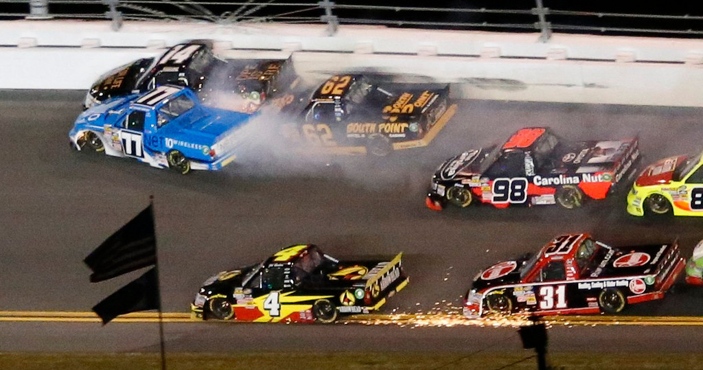 . Trucks crash during the NASCAR Camping World Truck Series NextEra Energy Resources 250 race at the Daytona International Speedway in Daytona Beach, Florida February 22, 2013. In upper left, Brendan Newberry in his number 14 Chevrolet, German Quiroga in his number 77 Toyota and Brendan Gaughan in his number 62 collide, while Jeb Burton in his number 4 Chevrolet and James Bueschek in his number 31 collide. The Daytona 500 NASCAR Sprint Cup race is scheduled for February 24.  REUTERS/Pierre Ducharme